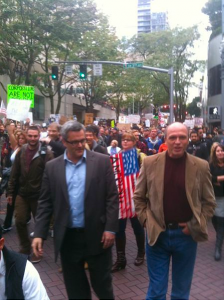 Occupy Portland Sam Adams and Randy Leonard marching with them.