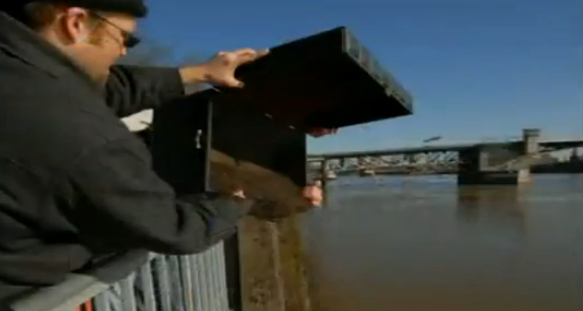 Founder of the Oregon Tea Party, Geoff Ludt, pouring TEA into Portland's Willamette River.