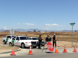Agents block the entrance to the Murrieta, California Border Patrol facility on July 7th. Photo by Victoria Taft for www.VictoriaTaft.com