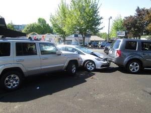 Crash at the car wash. Photo by the Oregonian.