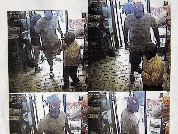 Michael Brown roughs up convenience store owner after ripping off Swisher Sweets cigars. Photo: Paul Martin Foreign Correspondent