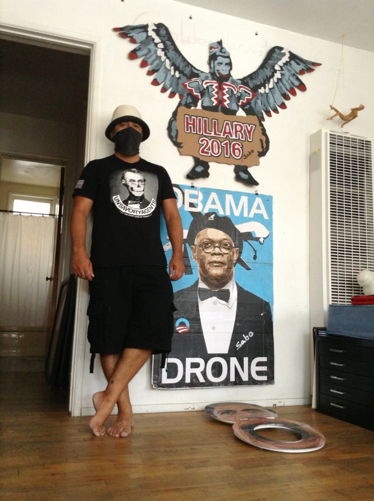 SABO with his Hillary Flying Monkeys creation and Samuel L Jackson Drone piece.  Photo: Victoria Taft