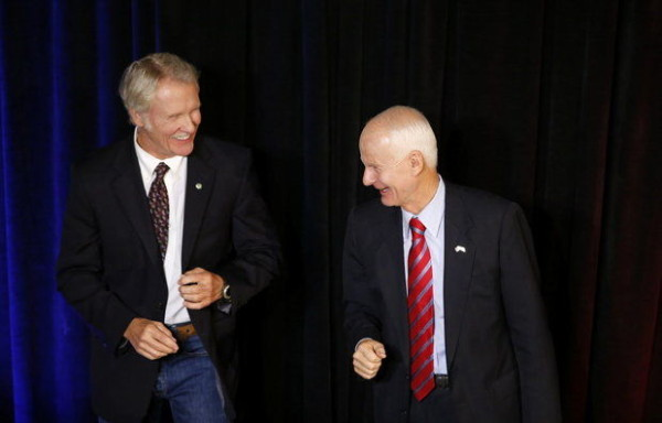 Kitzhaber and Republican opponent Dennis Richardson yuck it up at a confab in central Oregon. Image Credit: The Oregonian